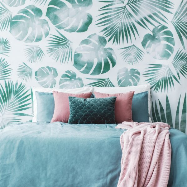 Room with leaf wallpaper